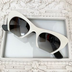 Miu Miu - Retro Cat Eye Cut Out Sunglasses